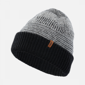 Thick, warm, and super soft, this reversible knit beanie lets you customize your cold-weather style. A ribbed cuff and leather KEEN logo tag add to this unique look. | Keen Reversed Press Beanie, In Black.