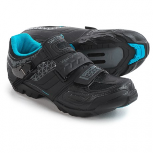 shimano sh-wm64 mountain bike shoes - spd (for women)- Save 41% Off - CLOSEOUTS . With a supportive midsole and a well-cushioned insole, Shimano SH-WM64 mountain bike shoes handle everything from all-day cross-country rides to technical singletrack. Dual offsetting straps relieve pressure points, and the lightweight rubber and fiberglass outsole provides traction out of the saddle. Available Colors: BLACK, WHITE. Sizes: 37, 38, 39, 40, 41, 42.
