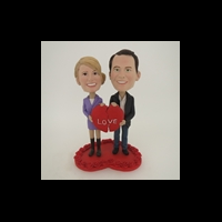 Custom Bobblehead Doll: Couple Holding Two Halves Of Heart